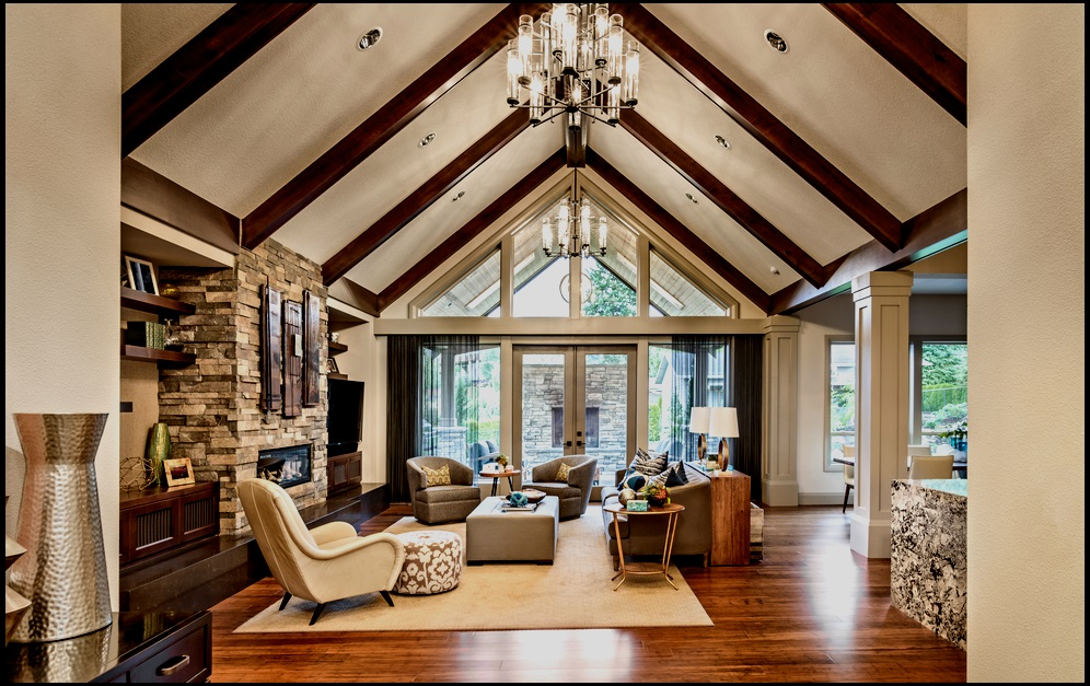 A contemporary keeping room uses natural stone and exposed beams to balance the light from big windows.