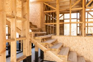 Salvaged building materials like beams, stairs, and framing supplies can save lots of money on home construction.